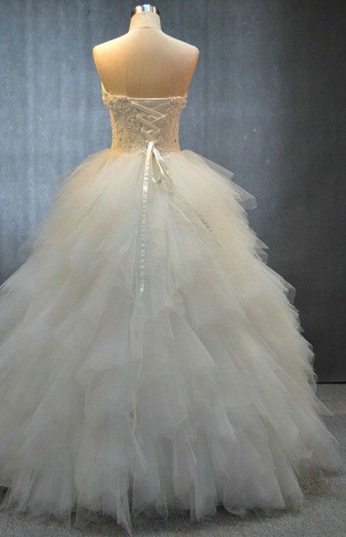 A bride can see corset bodice organza wedding gowns in the Darius Cordell Couture collection. Each one can be modified to her personal taste.