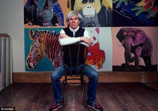 Warhol in front of his endangered species artworks.