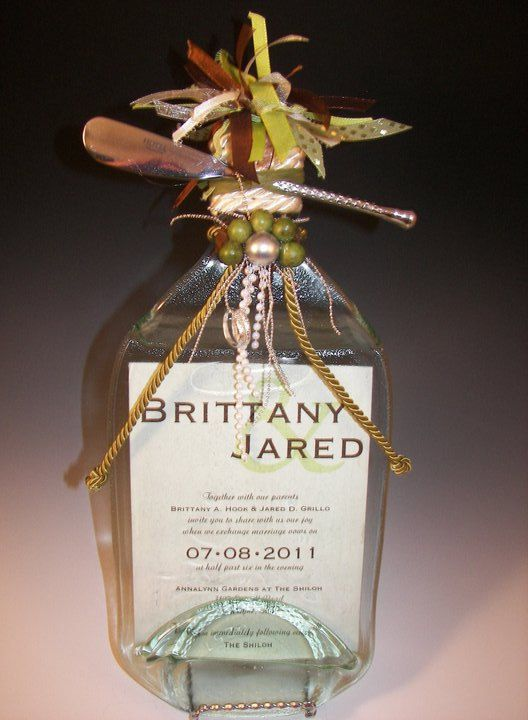 This unique eco-friendly wedding invitation keepsake is handcrafted from a recycled 1.5 liter clear wine bottle. This is a one-of-a-kind gift