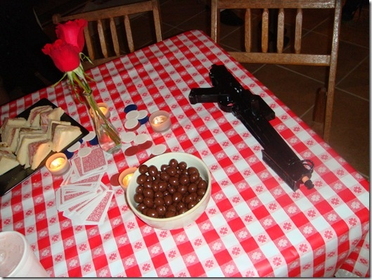 More ideas.....Mafia themed means red roses. Table cloth for cake and prop table at mafia themed party!