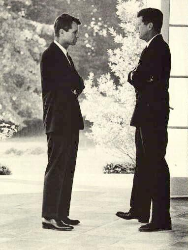 Attorney General Robert F. Kennedy and President John F. Kennedy talk during the height of the Cuban missile crisis.