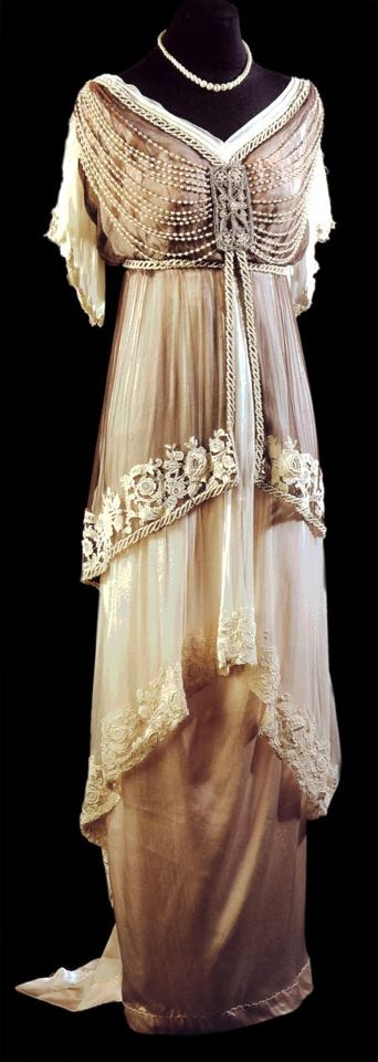 "I like the layered skirt and the beads from the bodice front to the shoulders. It's almost reminiscent of the ribcage.""Gown from Russia ~ 1913"""