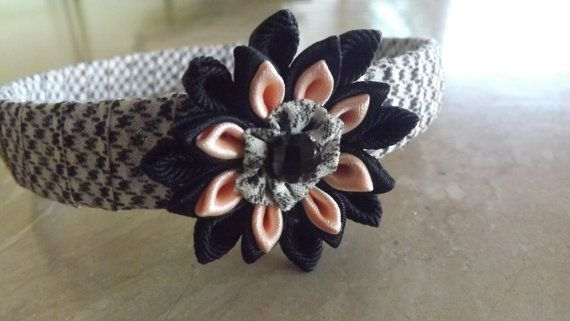 Hey, I found this really awesome Etsy listing at https://www.etsy.com/listing/179101265/kanzashi-flower-headband-with-black-and
