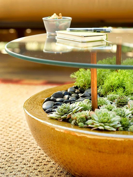 Outdoor Table: by sinking rubber-tipped copper pipe into a large, rock-filled planter holding succulents or plants that don't need a lot of water. Place at least four of the pipes at equal distances apart within the planter. Use weatherproof adhesive that works with glass and metal to secure a glass tabletop to the rubber pipes.