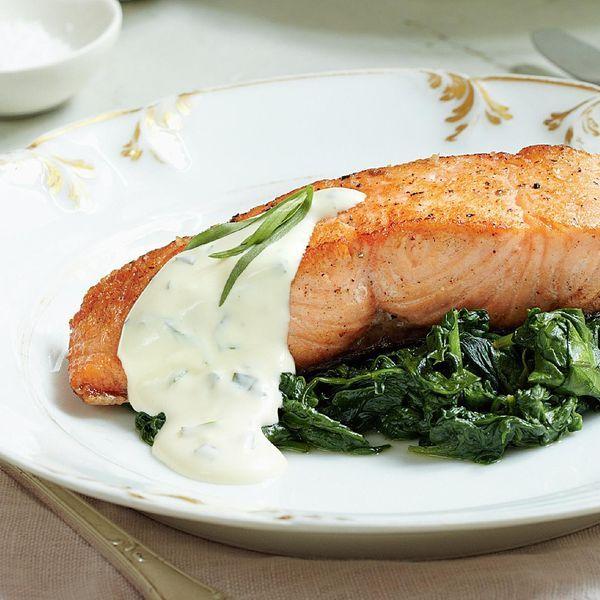 A refined salmon dish which is perfect for a dinner party. Wow your guests with this Mary Berry recipe, served with a creamy spinach, wine and tarragon sauce.