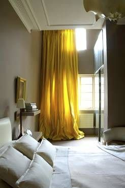 Grey walls with accent colour in yellow translated onto floor length window