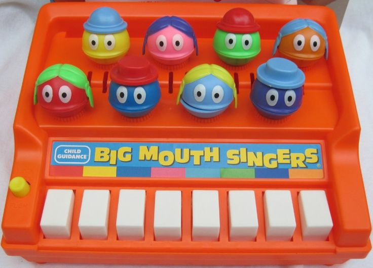 VINTAGE TOY ARCHIVE. Had this...loved how they'd open their mouth(s) when you'd push the keys. So cute!