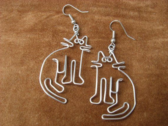 These are cute cat earrings. They are VERY LIGHT! This design was created by drawing it first, and then, with a LOT of practice, making it with wire. They are approx. 2 inches long with the hook. (see the coin photo). They are made of a wire that wont tarnish. The hook is nickle-free so there are no problems for people who have allergies. I will put a stopper on the hook also so you dont loose them!! Great for cat lovers