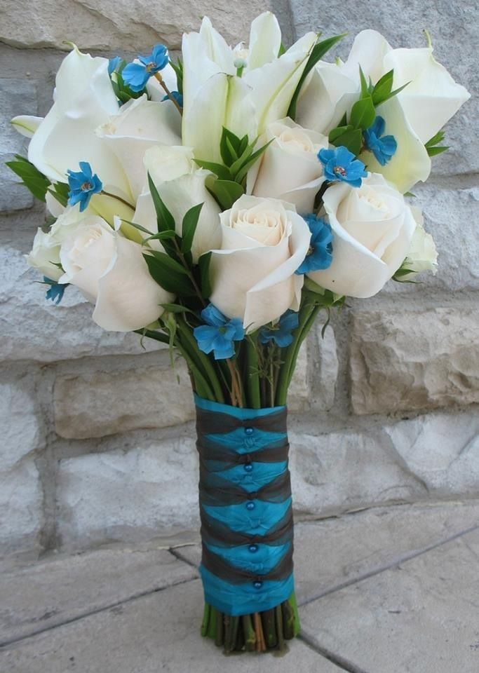 turquoise and grey bouquet | Teal wedding. White Roses and Calla Lillies with blue accent flowers