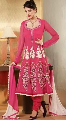 Gorgeous Pink Net Embroidered Kalidar Suit Its time for you to transform your drab days into fab days in this gorgeous pink net kalidar suit. Kameez featuring embroidered bold floral motifs over the waist line and bold floral motifs adorning the lower part of kalis with chainttley lace enhanced hemline gives a look worth flaunting. #EmbroideredKalidarSuit #BuyPartyWearLongAnarkaliSuits