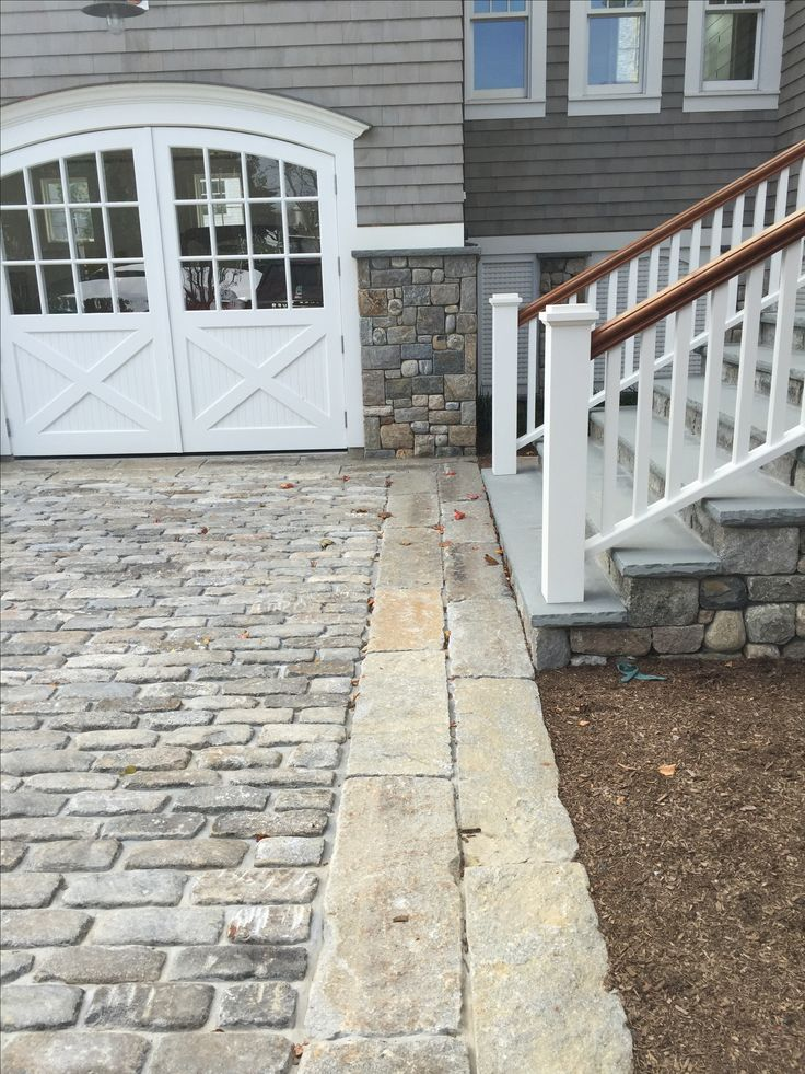 Big Dig Cobbles accented with reclaimed curbing as edging material.