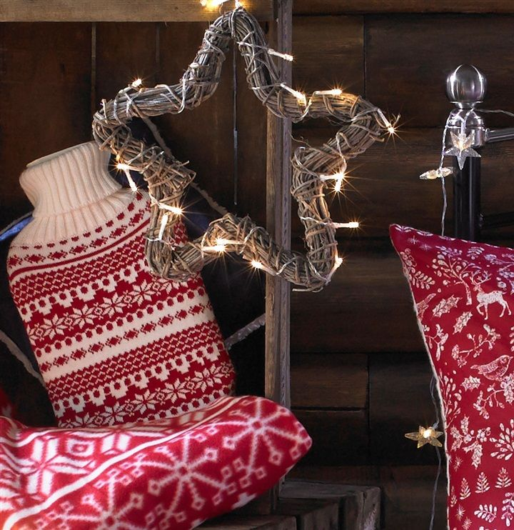 Festive vibes with our Primark Home-wicker star light, hot water bottle and fairisle throw.