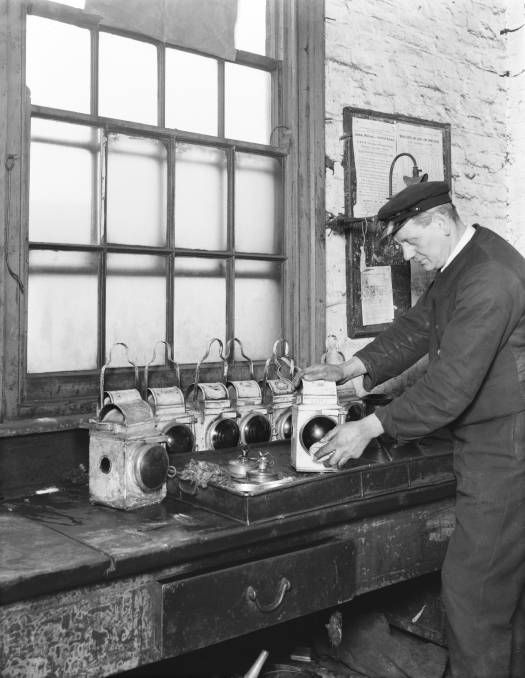 Lamp cleaner in Bletchley railway station, 1936
