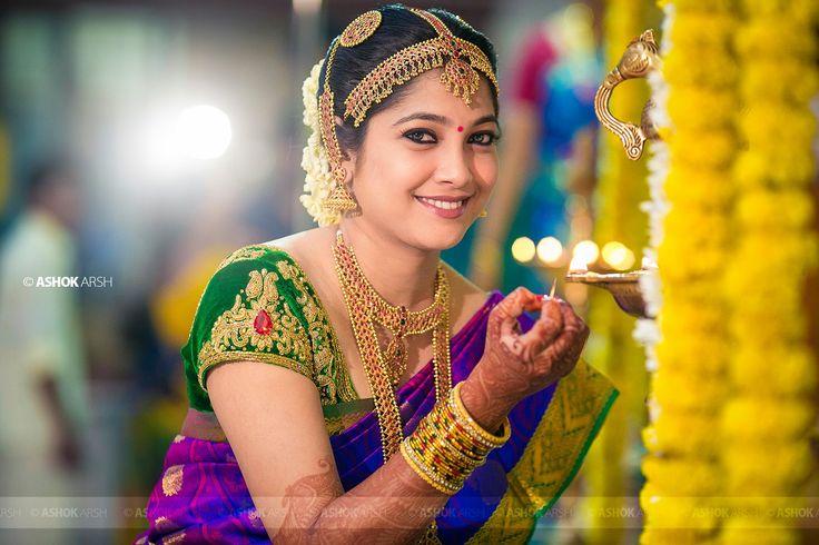 South Indian bride. Hindu bride. Kanchipuram silk sari with contrast blouse. Braid with fresh flowers.Temple jewelry. Tamil bride. Telugu bride. Kannada bride. Malayalee bride.