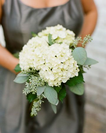 Large clusters of white hydrangea mixed with seeded eucalyptus.