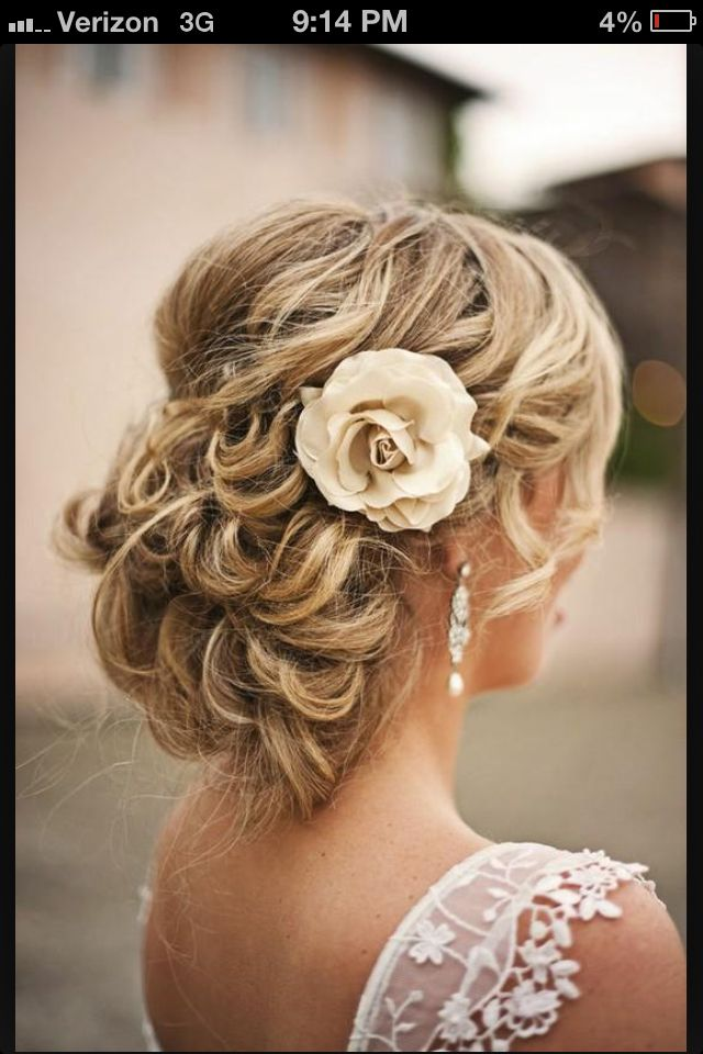 Wedding hair with a red rose