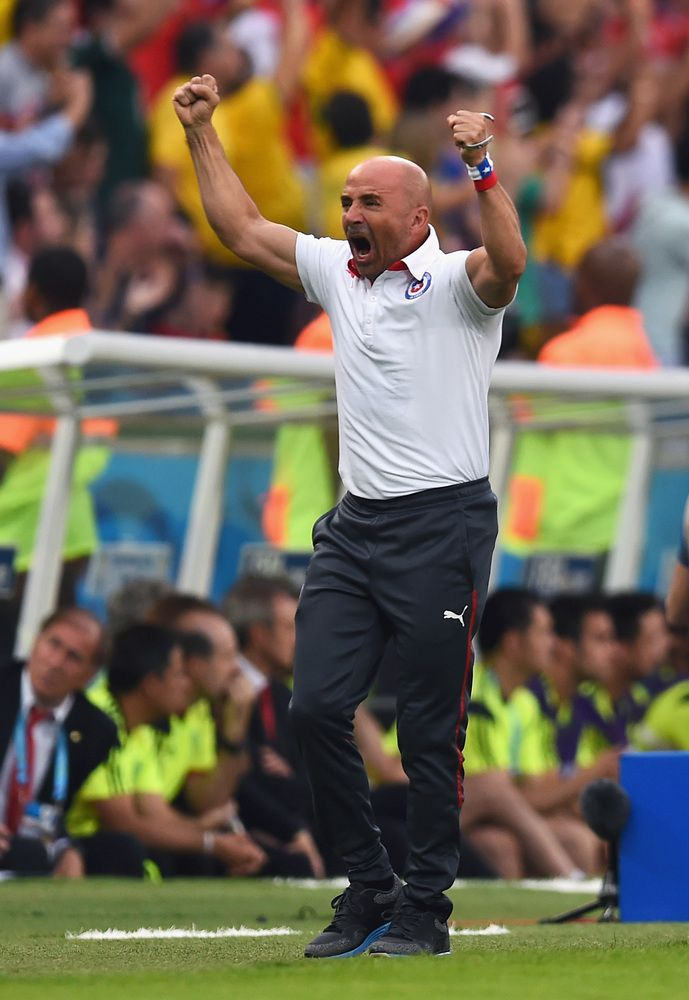 Spain Eliminated From World Cup With Devastating Loss To Chile - RIO DE JANEIRO, BRAZIL - JUNE 18: Head coach Jorge Sampaoli of Chile reacts after his team's first goal during the 2014 FIFA World Cup Brazil Group B match between Spain and Chile at Maracana on June 18, 2014 in Rio de Janeiro, Brazil. (Photo by David Ramos/Getty Images)