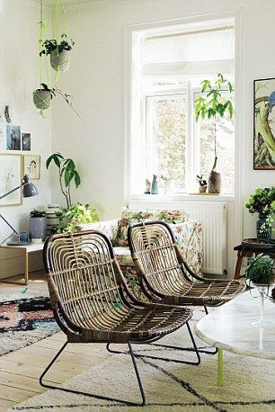 Bohemian Modern book by Emily Henson via The Daily Mail. Wicker chairs, house plants, macramé and shagpile rugs.