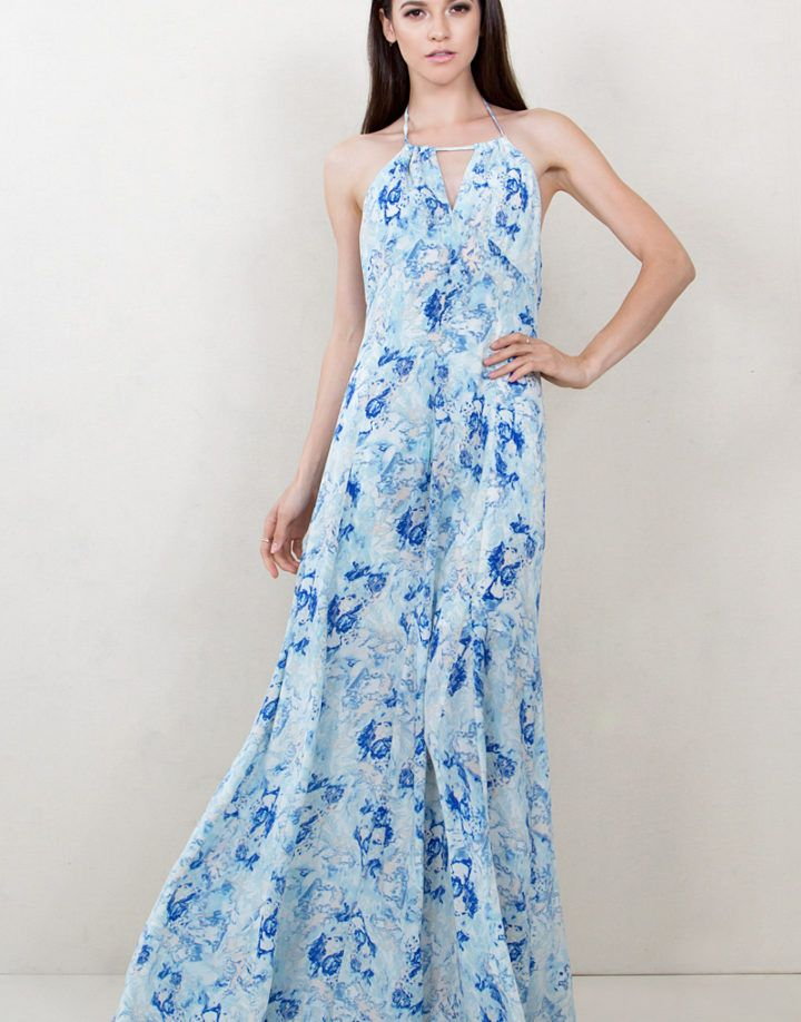 A gorgeous watercolor printed halter maxi dress. Keyhole opening in the front. Zipper closure on back.