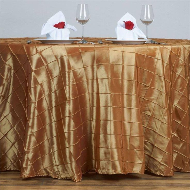 """Gold Pintuck Tablecloths 120"""" Round - Pintuck is actually a fold of fabric that is stitched intricately to hold it in a place, very much like a pleat. These lovely pleats impart a decorative effect to the fabric by fashioning a visual line at a chosen point. They effortlessly bridge vintage and contemporary styles to create a majestic new classic look. If you do not want your celebration to blend in with other weddings, birthdays, and anniversaries, try our premium quality pintuck…"""