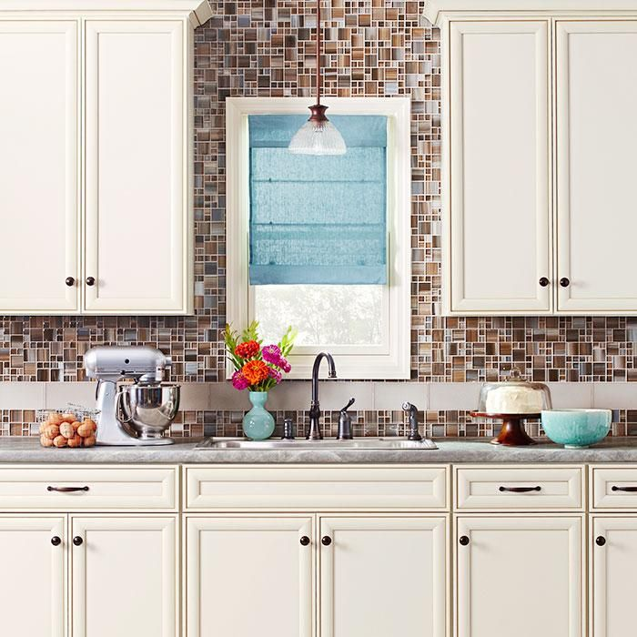 Kitchen Backsplash Off White Cabinets: Creamy Off-white Cabinets Paired With A Sophisticated