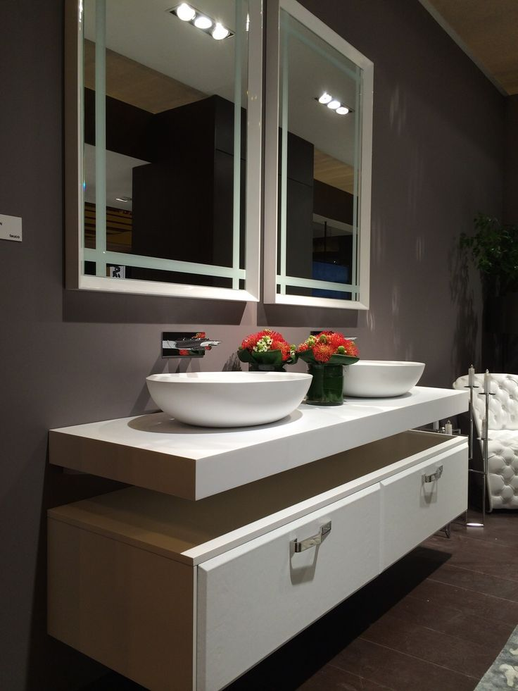 I Bordi #washbasins with two big mirrors framed in #white. We like also the touch of red of the flowers :) #design #bathroom