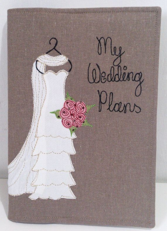 This personalised wedding planning notebook is an ideal engagement gift for a bride to be. The notebook cover is made from linen and cotton fabrics