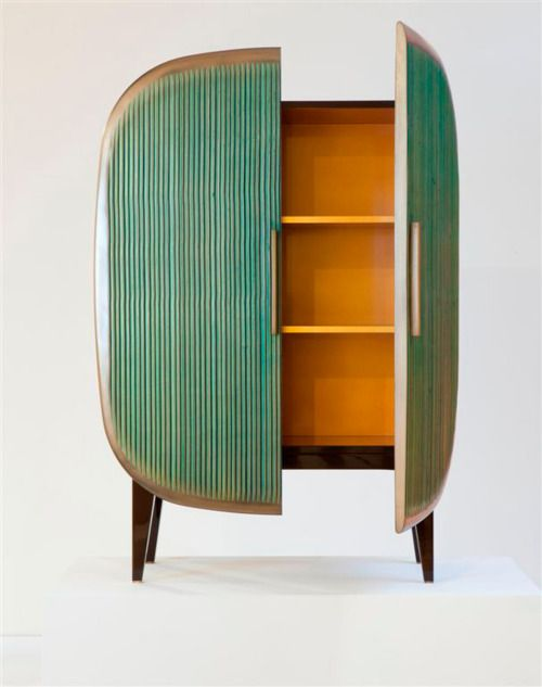 Modern atomic cabinet. I think you could take a open cabinet an find a table top without legs an turn it into the doors.
