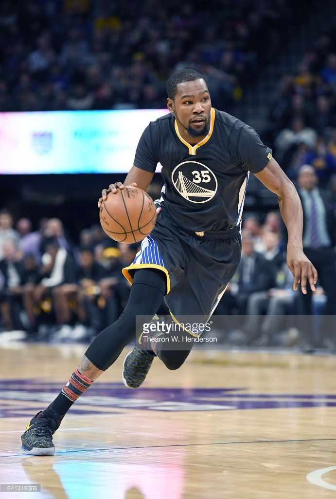 News Photo : Kevin Durant of the Golden State Warriors drives...
