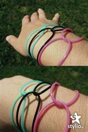 Jelly bracelets.  I mainly wore black ones, but I looped them like what is in the photo.