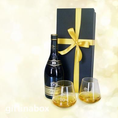 KWV BRANDY  For the brandy connoisseur ... a bottle of 10 year old vintage brandy and brandy tumblers in a black presentation box with ribbons and bows  KWV - 10 year old brandy 2 x brandy tumblers