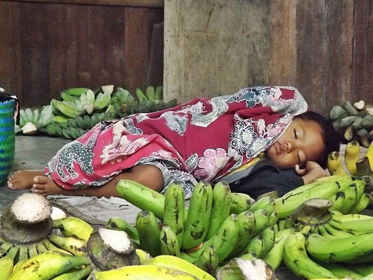 Sleeping baby in The market. Indonesia. Surabaya.
