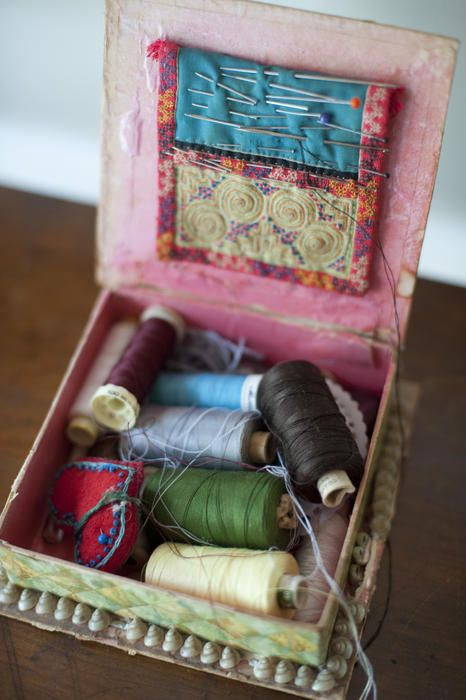 Free Stock Photo: Open sewing box with reels of colorful thread and needles and pins in a cushion in the lid in a high angle view - By freeimageslive contributor: gratuit