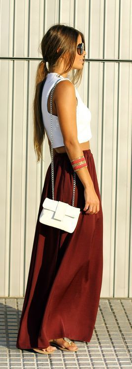 white crop top with reddish brown maxi skirt and white purse