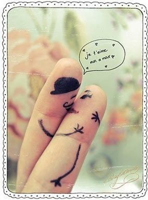 Two fingers drawn on to look like French sweethearts kissing! :) This is the cutest thing I've ever seen! Thank you for sharing!