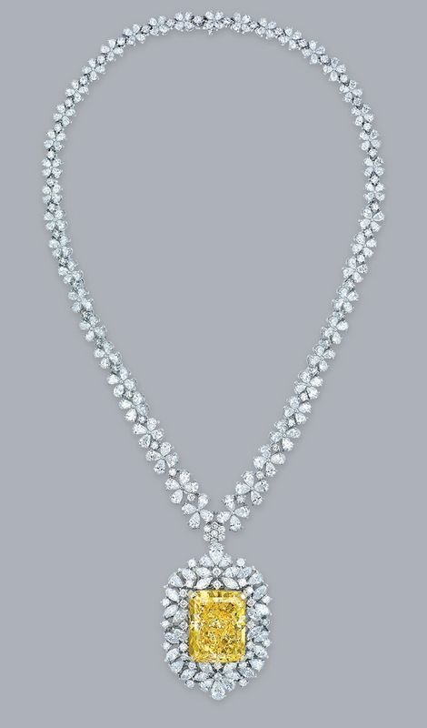 An impressive coloured diamond and diamond pendant necklace More