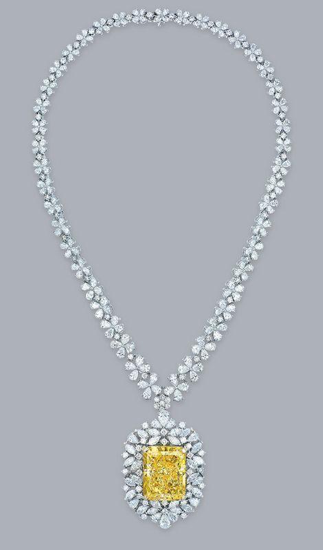 An impressive coloured diamond and diamond pendant necklace