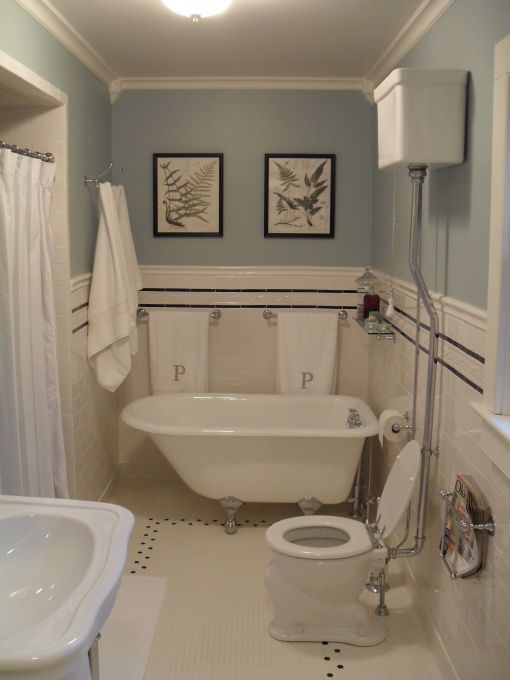 1920s style hex floor subway black and white bathroom.