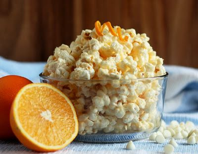 Orange Creamsicle Popcorn.  Gooey sticky popcorn that tastes just like an orange creamsicle.