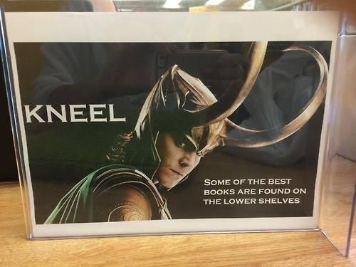 """Guys, this was made by the best librarian ever. """"KNEEL...Some of the best books are found in the lower shelves."""""""