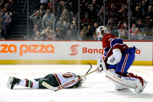 Devin Setoguchi of the Minnesota Wild falls down during a shootout and Pricey is outta there before Seto even hits the ground. What a champ