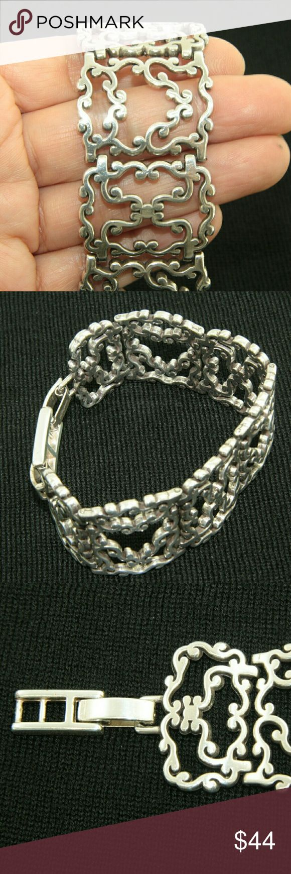 Brighton Bracelet Brighton Bracelet. Silver tone. 1.25 inches tall.  Loose fit. 8 inches in length.  Used item: any wear shown in pictures.  Excellent condition!  Bundle Up!  Offers Always Welcome :) Brighton Jewelry Bracelets