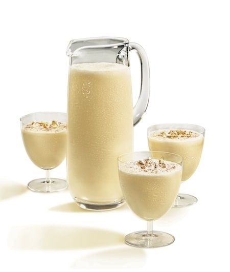 Eggnog  1 large grade AA egg, separated 2 tsp superfine sugar 1 oz heavy cream 1/2 tsp pure almond extract 1/2 tsp pure vanilla extract 1 1/2 oz Mount Gay rum dashes of grated cinnamon and nutmeg for garnish