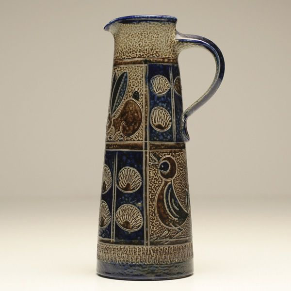 """Blue MCM Scandinavian sgraffito ceramic pitcher; Signed bottom with animal and shell decoration throughout. 9 3/8"""" H"""