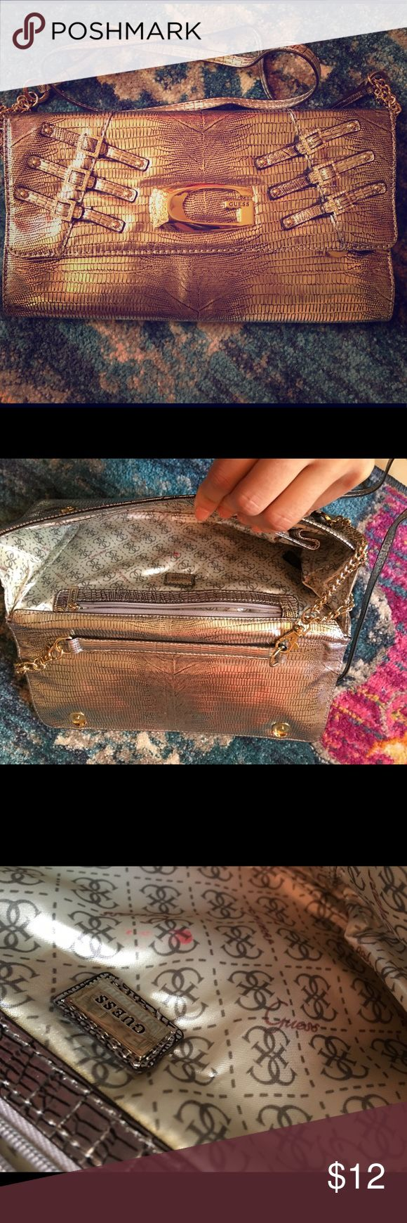 Guess metallic clutch Used several times.  It does have mark (as shown). Great condition.  Take it for a spin in the town⚡️🌟⭐️☺️ Bags Clutches & Wristlets
