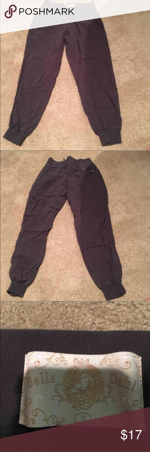 Joggers size small Like New Grey / brown joggers. Light weight with zipper pockets in front and one in back. Elastic waistband and ankles. Size small. In perfect condition, barely worn. Pants Track Pants & Joggers