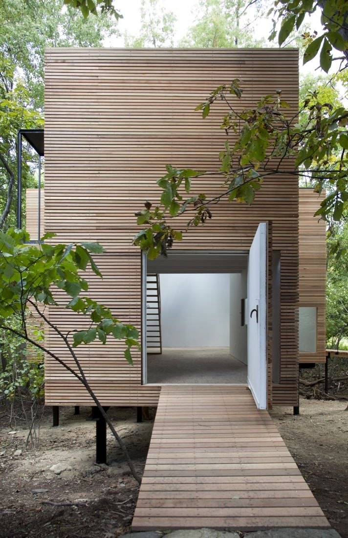 "Built by Steven Holl Architects in Dutchess, United States with date 2010. Images by Susan Wides. On a four acre site in Dutchess County, New York, a new wooden ""T"" space sits near a stone ""U"" house from 1952, which..."