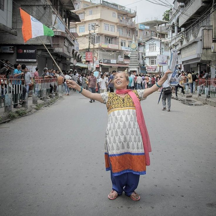 Photo by @brihatr  Sabitri Giri 56 a loyal party member of GJMM on the street of Kalimpong India holding the National Flag after the protest rally. Kalimpong Unrest  Gorkhaland Agitation  #portrait #politics #nationaltricolour #environment #document #space #time #everydaykalimpong #indiaphotoproject #creativeimagemagazine #nikonindiaofficial #protest  #faces #public
