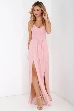 If you're looking for a number that will never lose its elegance and fashion appeal, you've come to the right place! The Bariano Test of Time Blush Pink Maxi Dress has a gently sloping neckline (with no-slip strips) topped by dainty chiffon spaghetti straps in a soft blush pink hue. The chiffon continues into a bodice with lightly padded cups, hidden boning, plus diagonal and vertical pleats that transition from the fitted waist into a sweeping maxi skirt with two side slits. Hidden back…