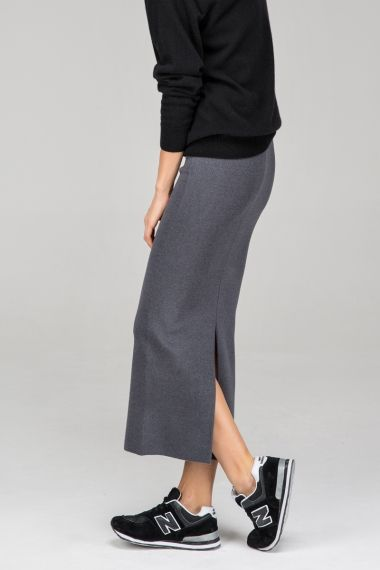 <p>Made from a poly-blend fabric. Elasticated high-rise waist. Split to reverse. Bodycon fit. About me:. 5% polyester,53% acrylic,42% artificial wool</p>